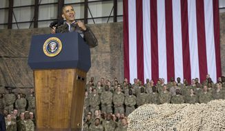 FILE - This May 25, 2014 file photo shows President Barack Obama speaking during a troop rally after arriving at Bagram Air Field for an unannounced visit, north of Kabul, Afghanistan. Senior U.S. administration officials say President Barack Obama will seek to keep 9,800 U.S. troops in Afghanistan after the war formally ends later this year. Nearly all of those forces are to be out by the end of 2016, as Obama finishes his second term. (AP Photo/ Evan Vucci, File)