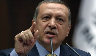 ** FILE ** Turkey's Prime Minister Recep Tayyip Erdogan addresses members of his ruling party in parliament in Ankara, Turkey, Tuesday, May 27, 2014. (AP Photo/Burhan Ozbilici)