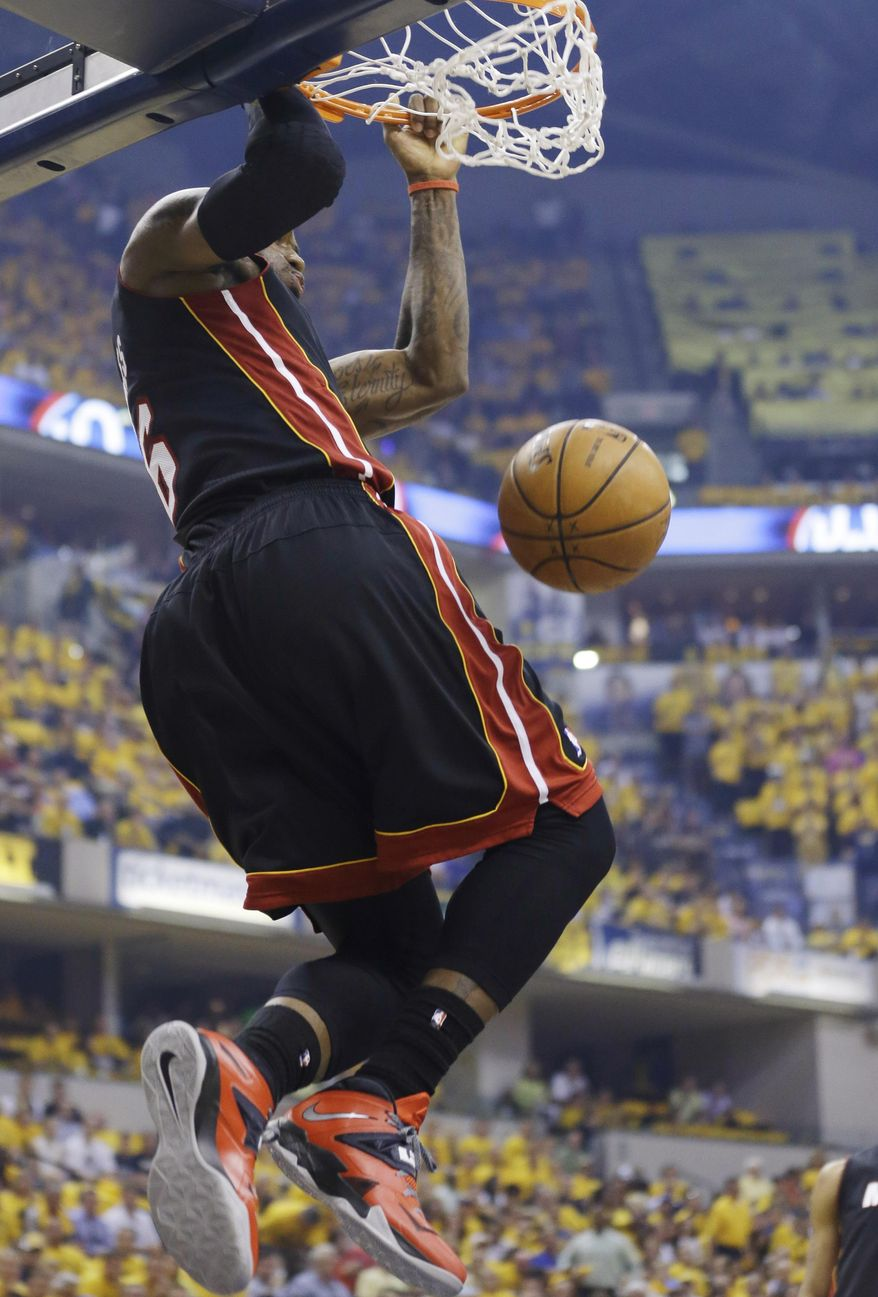 Miami Heat forward LeBron James dunks against the Indiana Pacers during the first half of Game 5 of the NBA basketball playoffs Eastern Conference finals, in Indianapolis on Wednesday, May 28, 2014. (AP Photo/Michael Conroy)