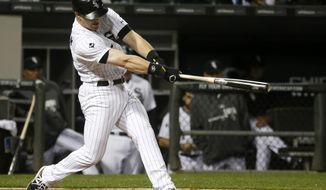 Chicago White Sox's Gordon Beckham swings through his home run off Cleveland Indians relief pitcher Mark Lowe during the fifth inning of a baseball game Tuesday, May 27, 2014, in Chicago. (AP Photo/Charles Rex Arbogast)