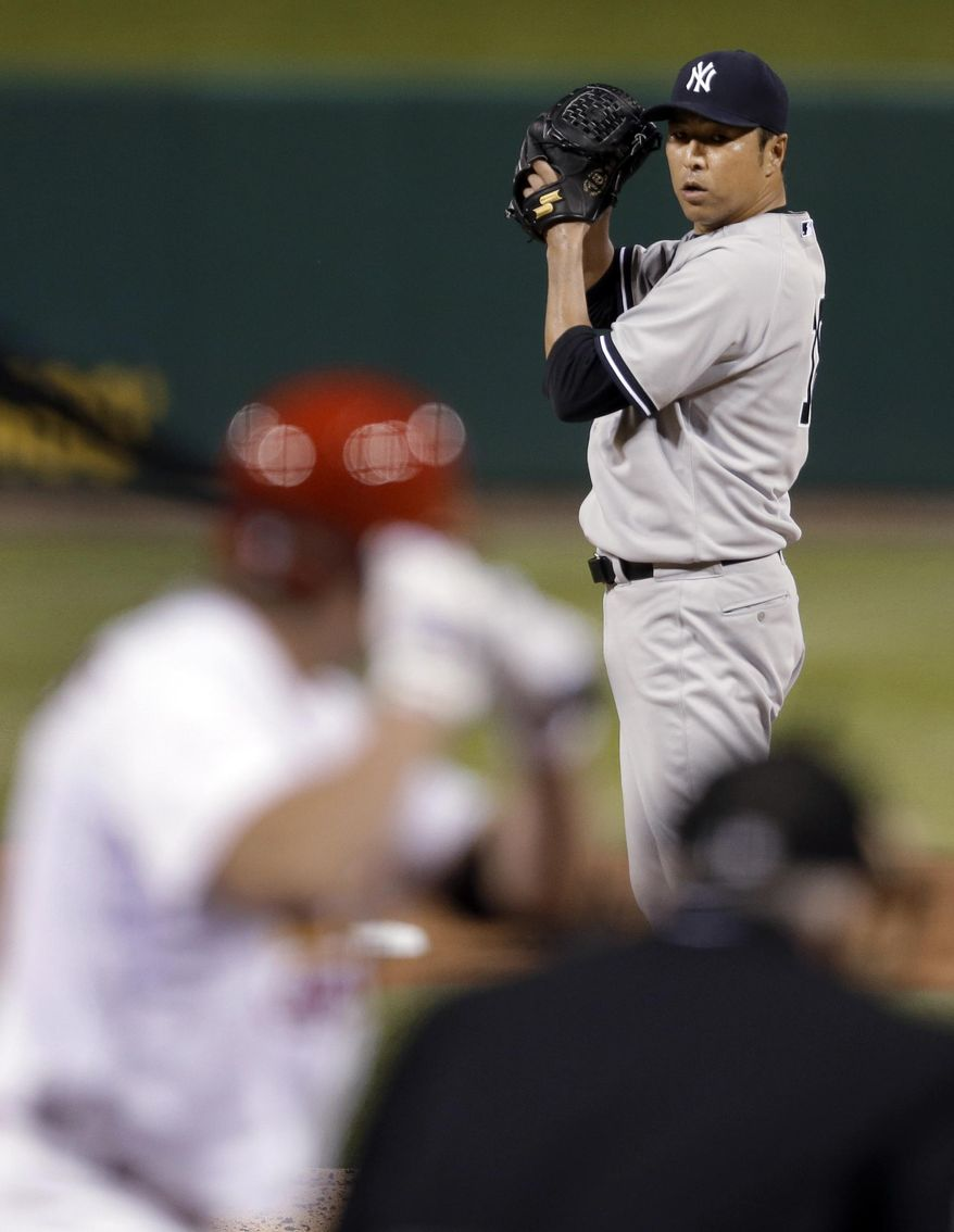 New York Yankees starting pitcher Hiroki Kuroda prepares to deliver during the fourth inning of a baseball game against the St. Louis Cardinals on Wednesday, May 28, 2014, in St. Louis. (AP Photo/Jeff Roberson)