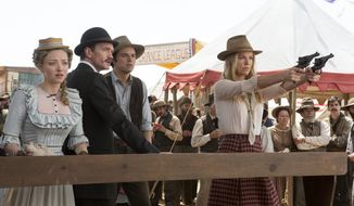 "This image released by Universal Pictures shows, from left, Amanda Seyfried, Neil Patrick Harris, Seth MacFarlane and Charlize Theron in a scene from ""A Million Ways to Die in the West."" (AP Photo/Universal Pictures)"
