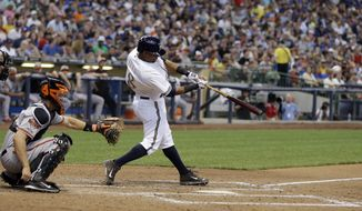 Milwaukee Brewers' Khris Davis hits a home run during the sixth inning of a baseball game against the Baltimore Orioles Monday, May 26, 2014, in Milwaukee. (AP Photo/Morry Gash)