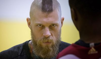 Miami Heat's Chris Andersen talks to coach Juwan Howard after a practice session in Miami, Thursday, May 22, 2014, as they prepare for  game three in their playoff series against the Indiana Pacers. (AP Photo/J Pat Carter)