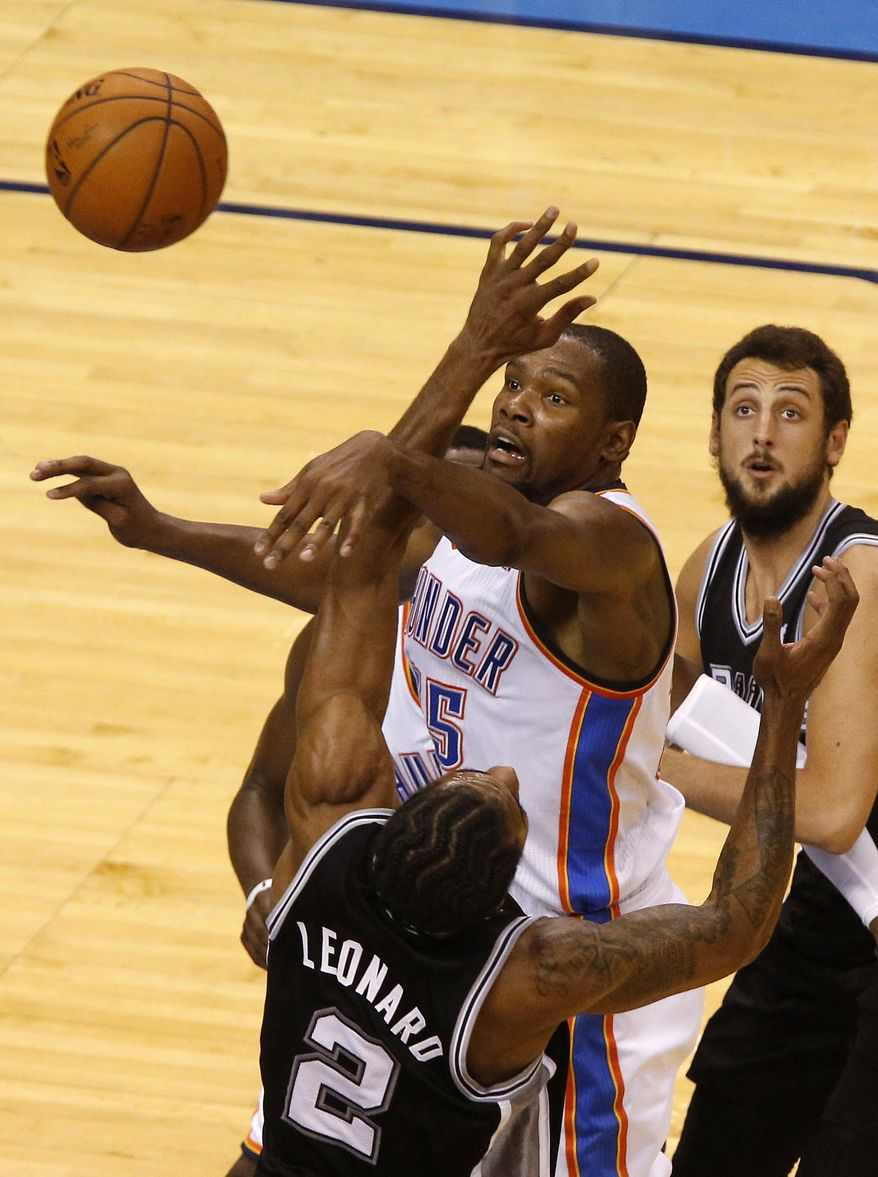 Oklahoma City Thunder forward Kevin Durant (35) hits the ball away from San Antonio Spurs forward Kawhi Leonard (2) and guard Marco Belinelli in the second half of Game 4 of the Western Conference finals NBA basketball playoff series in Oklahoma City, Tuesday, May 27, 2014. (AP Photo/Garett Fisbeck)