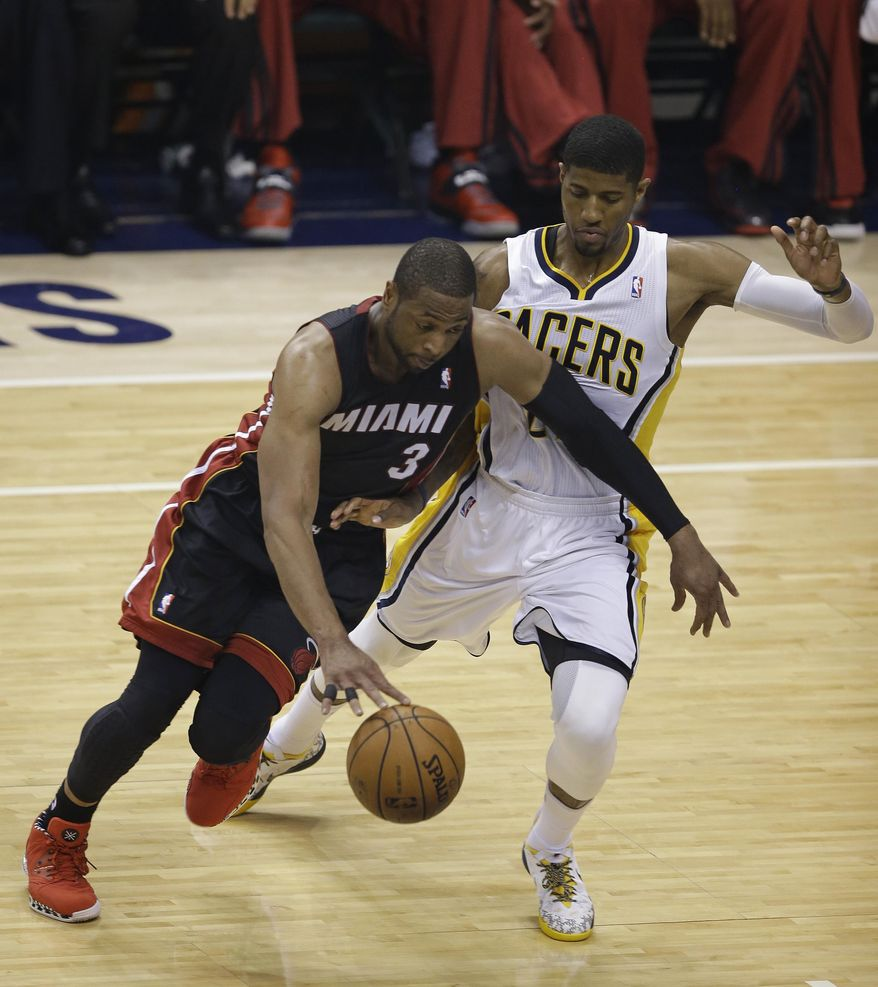 Miami Heat's Dwyane Wade goes to the basket against Indiana Pacers' Paul George during the first half of Game 5 of the Eastern Conference finals NBA basketball playoff series Wednesday, May 28, 2014, in Indianapolis. (AP Photo/Darron Cummings)