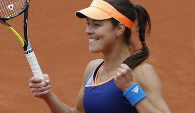 Serbia's Anna Ivanovic celebrates winning the first round match of the French Open tennis tournament in two sets against France's Caroline Garcia at the Roland Garros stadium, in Paris, France, Tuesday, May 27, 2014. (AP Photo/Michel Spingler)