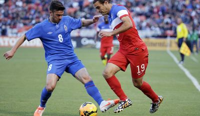 United States' Graham Zusi, right, goes for the ball against Azerbaijan's Gara Garayev during the first half of an international friendly soccer match on Tuesday, May 27, 2014, in San Francisco. (AP Photo/Marcio Jose Sanchez)