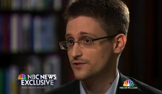 In this image taken from video provided by NBC News on Tuesday, May 27, 2014, Edward Snowden, a former National Security Agency (NSA) contractor, speaks to NBC News anchor Brian Williams during an NBC Exclusive interview. Snowden told Williams that he worked undercover and overseas for the CIA and the NSA. (AP Photo/NBC News)