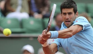 Serbia's Novak Djokovic returns the ball to France's Jeremy Chardy during their second round match of  the French Open tennis tournament at the Roland Garros stadium, in Paris, France, Wednesday, May 28, 2014. (AP Photo/David Vincent)