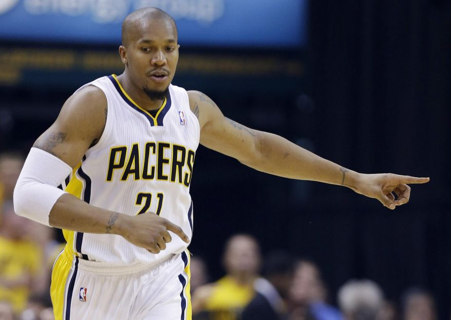 Indiana Pacers forward David West gestures as he runs up the court during the first half against the Miami Heat in Game 5 of the NBA basketball Eastern Conference finals in Indianapolis, Wednesday, May 28, 2014. (AP Photo/Michael Conroy)