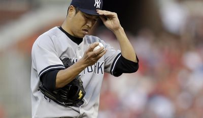 New York Yankees starting pitcher Hiroki Kuroda adjusts his cap during the first inning of a baseball game against the St. Louis Cardinals on Wednesday, May 28, 2014, in St. Louis. (AP Photo/Jeff Roberson)