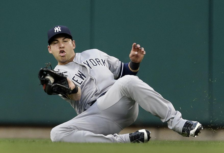 New York Yankees center fielder Jacoby Ellsbury slides and catches a ball hit by St. Louis Cardinals' Allen Craig for an out during the second inning of a baseball game Wednesday, May 28, 2014, in St. Louis. (AP Photo/Jeff Roberson)