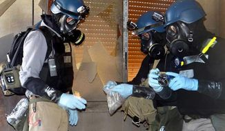 This citizen journalism image from Aug. 29, 2013, shows a United Nations investigation team taking samples of suspected chemical weapons in Syria. (AP Photo)