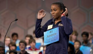 "Eighth grade student Amber Robinson, 14, of Herbert A. Ammons Middle School, Miami, Fla., expresses her struggle to spell the word, ""pelagial"" during the preliminaries, round three of the Scripps National Spelling Bee, Wednesday, May 28, 2014, at National Harbor in Oxon Hill, Md.  Robinson failed to spell the word correctly as she spelled it, polagial.   (AP Photo/Manuel Balce Ceneta)"