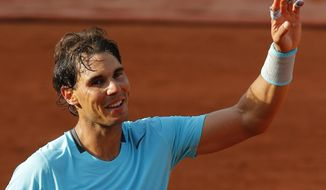 Spain's Rafael Nadal waves after defeating Robby Ginepri of the U.S. after their first round match of  the French Open tennis tournament at the Roland Garros stadium, in Paris, France, Monday, May 26, 2014. Nadal won 6-0, 6-3, 6-0.  (AP Photo/Michel Spingler)