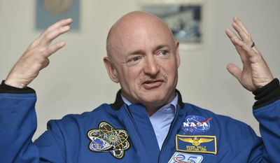 FILE - In this July 25, 2012 file photo, Mark Kelly, retired NASA astronaut and commander of mission STS-134, briefs the media at the European Organization for Nuclear Research in Meyrin near Geneva, Switzerland. Mark and his twin Scott Kelly are taking part in an unprecedented study of identical twins looking into the effects of prolonged weightlessness. Mark will undergo tests on Earth while his brother Scott will embark on a one-year space station stint. (AP Photo/Keystone/Martial Trezzini, File)