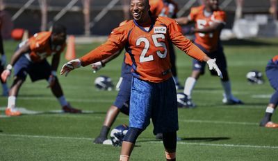 Denver Broncos cornerback Chris Harris Jr., stretches during an NFL football organized team activity, Wednesday, May 28, 2014, in Englewood, Colo. (AP Photo/Jack Dempsey)