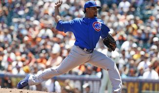 Chicago Cubs pitcher Edwin Jackson throws to the San Francisco Giants during the first inning of a baseball game, Wednesday, May 28, 2014, in San Francisco. (AP Photo/George Nikitin)