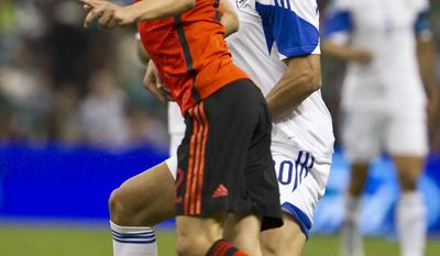 Mexico's Paul Aguilar, left, fights for the ball with Israel's Omri Ben during a friendly soccer match in Mexico City, Wednesday, May  28, 2014. (AP Photo/Christian Palma)