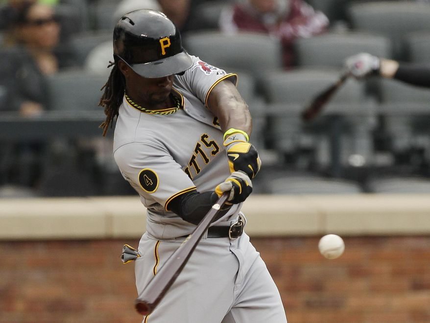 Pittsburgh Pirates' Andrew McCutchen hits a single during the eighth inning of a baseball game against the New York Mets Wednesday, May 28, 2014, in New York. (AP Photo/Frank Franklin II)