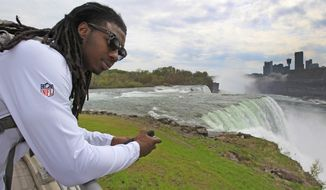 Sammy Watkins from Clemson University and the number one draft pick of the Buffalo Bills looks over Niagara Falls during a rookie tour on, Wednesday, May 21, 2014. (AP Photo/The Buffalo News, Harry Scull Jr.)