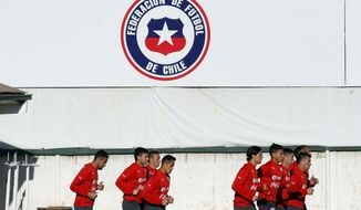 Chile's soccer players warm up for a training session in Santiago, Chile, Wednesday, May 28, 2014. Chile will play a friendly match with Egypt in Santiago on Friday prior to competing at the World Cup in Brazil in June.  (AP Photo/Luis Hidalgo)
