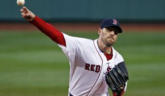 Boston Red Sox starting pitcher John Lackey delivers to the Atlanta Braves in the first inning of a baseball game at Fenway Park in Boston, Wednesday, May 28, 2014. (AP Photo/Elise Amendola)