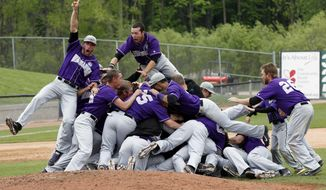 In this photo taken on Tuesday, May 27, 2014, members of the UW-Whitewater baseball team celebrate their NCAA Division III baseball championship at Fox Cities Stadium in Grand Chute, Wis. UW-Whitewater defeated Emory 7-0 for an unprecedented NCAA men's championship sweep in 2013-'14, as the Warhawks added to their titles in football and men's basketball won earlier this year.(AP Photo/Milwaukee Journal-Sentinel, Mark Hoffman)