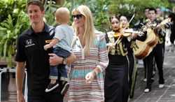 Indianapolis 500 winner Ryan Hunter-Reay hold his son Ryden, as he and his wife Beccy Gordon Hunter-Reay walk to a speaking engagement at Joe T Garcia's in Fort Worth, Texas, Wednesday, May 28, 2014. The were followed by Mariachi Real de Alvarez. He was in town to promote the Firestone 600 at TMS on June 7. (AP Photo/The Dallas Morning News, Michael Ainsworth)  MANDATORY CREDIT; MAGS OUT; TV OUT; INTERNET USE BY AP MEMBERS ONLY; NO SALES