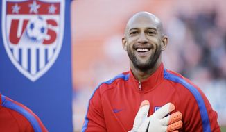 United States goalkeeper Tim Howard smiles during player introductions before an international friendly soccer match against Azerbaijan on Tuesday, May 27, 2014, in San Francisco. (AP Photo/Marcio Jose Sanchez)