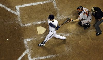 Milwaukee Brewers' Jonathan Lucroy hits an RBI single during the ninth inning of a baseball game against the Baltimore Orioles Tuesday, May 27, 2014, in Milwaukee. (AP Photo/Morry Gash)