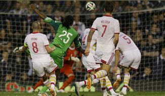 Nigeria's Michael Uchebo, second left, scores a goal during the international friendly soccer match between Nigeria and Scotland at Craven Cottage Stadium in London, Wednesday, May 28, 2014. (AP Photo/Kirsty Wigglesworth)