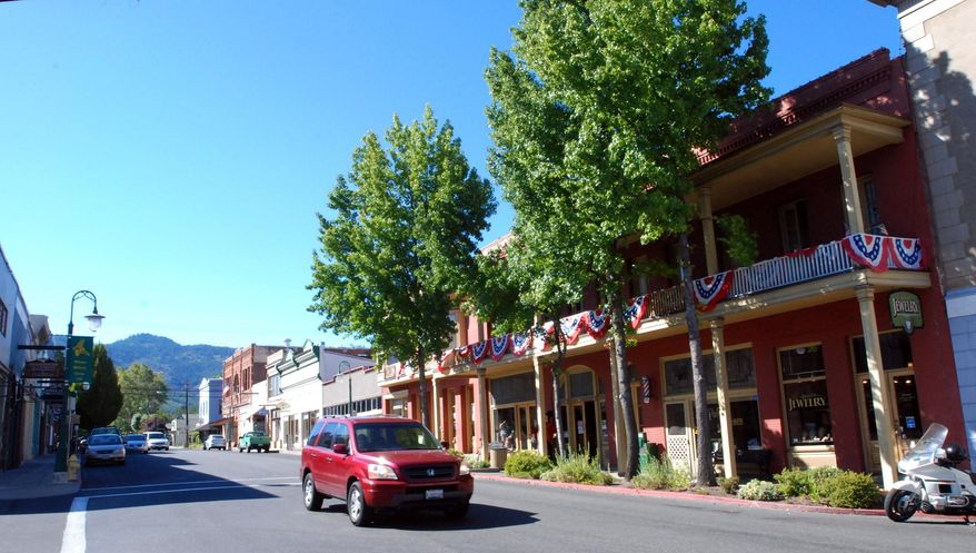 ** FILE ** In this Sept. 6, 2013, photo, a car is driven down Miner Street past the historic Franco American Hotel in Yreka, Calif. (AP Photo/Jeff Barnard,File)