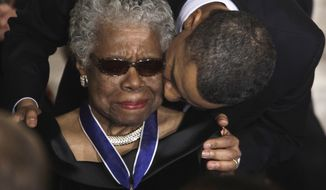 """FILE - In this Feb. 15, 2011 file photo, President Barack Obama kisses author and poet Maya Angelou after awarding her the 2010 Medal of Freedom during a ceremony in the East Room of the White House in Washington. Angelou, author of """"I Know Why the Caged Bird Sings,"""" has died, Wake Forest University said Wednesday, May 28, 2014.  She was 86. (AP Photo/Charles Dharapak, File)"""