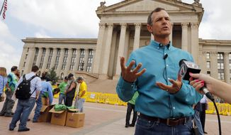 Chip Paul, chairman Oklahomans for Health, speaks with the media during a medical marijuana rally at the State Capitol on May 28, 2014 in Oklahoma City, Okla. The rally is formal launch of a signature drive to get a medical marijuana measure on a statewide ballot.  (AP Photo/The Oklahoman, Steve Sisney)