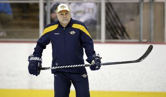 Nashville Predators head coach Barry Trotz watches during NHL hockey training camp on Monday, Jan. 14, 2013, in Nashville, Tenn. The shortened, 48-game season begins Saturday, January 19. (AP Photo/Mark Humphrey)