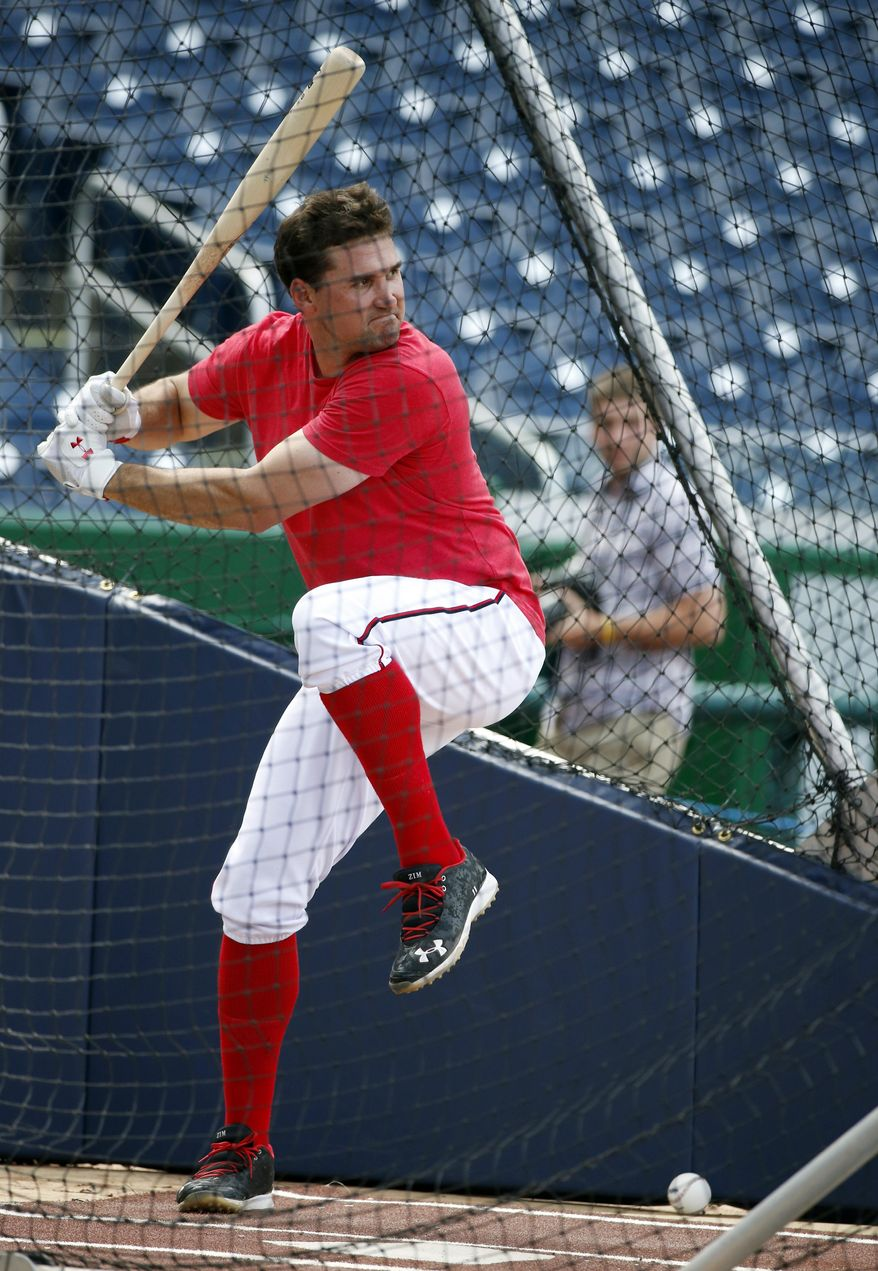 Washington Nationals third baseman Ryan Zimmerman bats during batting practice before the Nationals' baseball game against the Miami Marlins at Nationals Park on Wednesday, May 28, 2014, in Washington. Zimmerman is on the disabled list with a broken thumb, and was recently cleared to swing a bat. (AP Photo/Alex Brandon)
