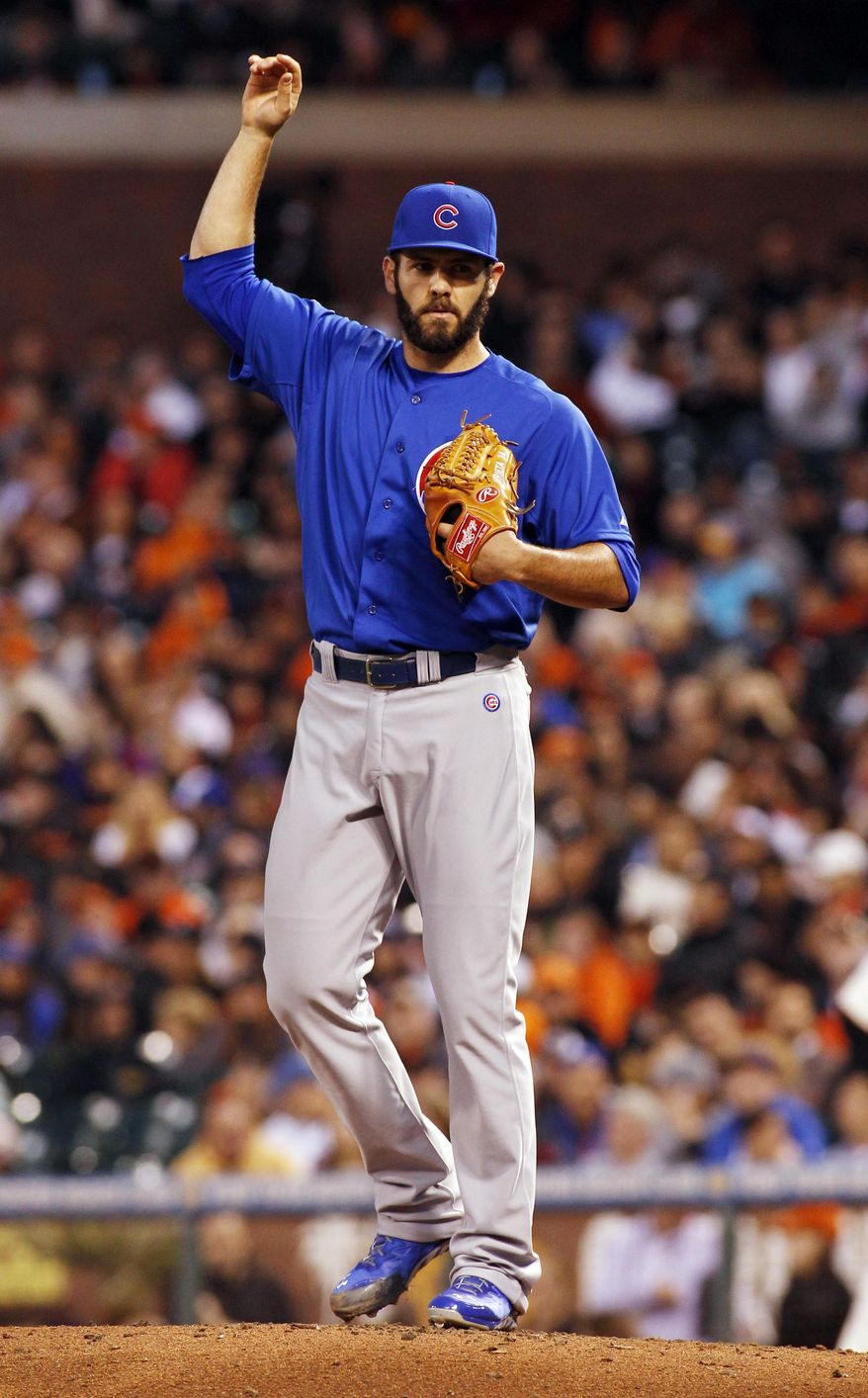 Chicago Cubs pitcher Jake Arrieta lifts his arm during the fifth inning of a baseball game against the San Francisco Giants, Tuesday, May 27, 2014, in San Francisco. (AP Photo/George Nikitin)