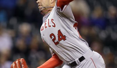 Los Angeles Angels relief pitcher Sean Burnett throws against the Seattle Mariners in the seventh inning of a baseball game Tuesday, May 27, 2014, in Seattle. Burnett left the game moments later with an apparent injury. (AP Photo/Elaine Thompson)