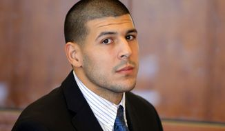 FILE - In this Oct. 9, 2013 file photo, former New England Patriots NFL football player Aaron Hernandez attends a pretrial court hearing in Fall River, Mass. Hernandez is due in court Wednesday, May 28, 2014 to be arraigned on murder charges for allegedly ambushing and gunning down two men in 2012 after a chance encounter inside a Boston nightclub. (AP Photo/Brian Snyder, Pool, File)