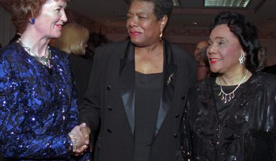 FILE - In this Oct. 5, 1996 file photo, then Irish President Mary Robinson, left, speaks with American poet Maya Angelou, center, and Coretta Scott King, wife of civil rights leader Martin Luther King, during the International Women's Forum in Boston. Angelou, a Renaissance woman and cultural pioneer, has died, Wake Forest University said in a statement Wednesday, May 28, 2014. She was 86. (AP Photo/Jim Rogash, File)