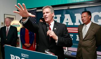 ** FILE ** Scott Brown accepts the endorsements of Sen. Kelly Ayotte and two former New Hampshire governors in Nashua. (Associated Press)
