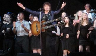 "Bon Jovi guitarist Richie Sambora performs a new song, ""Lighthouse"" at an anti-drug forum in Toms River N.J. on May 27, 2014. The song will raise money for a drug treatment center in New Jersey.(AP Photo/Wayne Parry)"