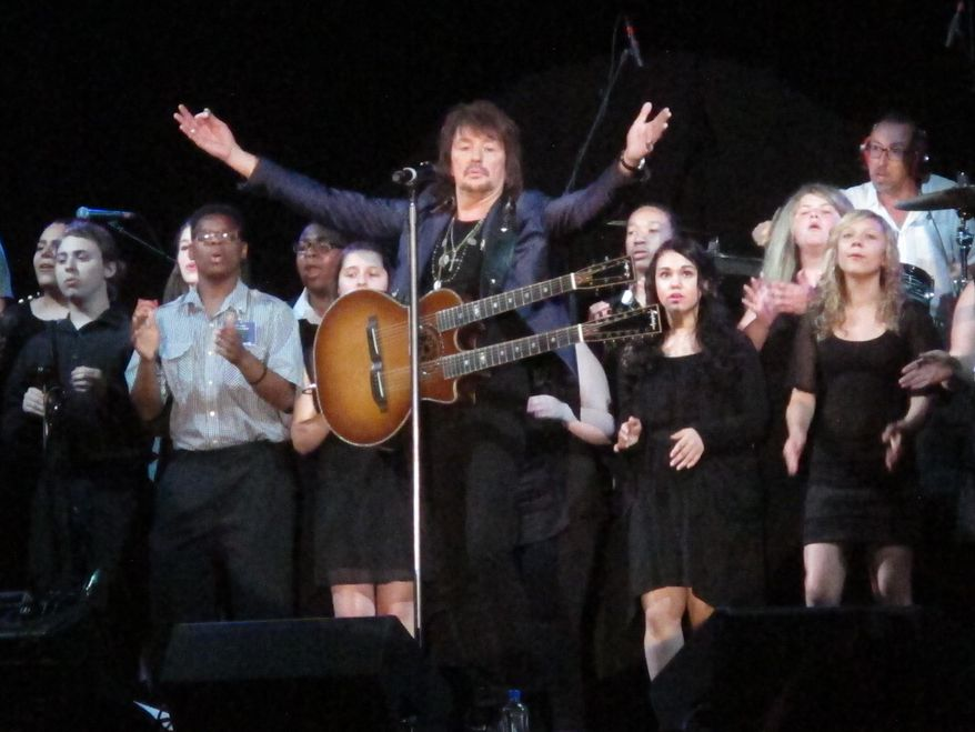 """Bon Jovi guitarist Richie Sambora performs a new song, """"Lighthouse"""" at an anti-drug forum in Toms River N.J. on May 27, 2014. The song will raise money for a drug treatment center in New Jersey.(AP Photo/Wayne Parry)"""