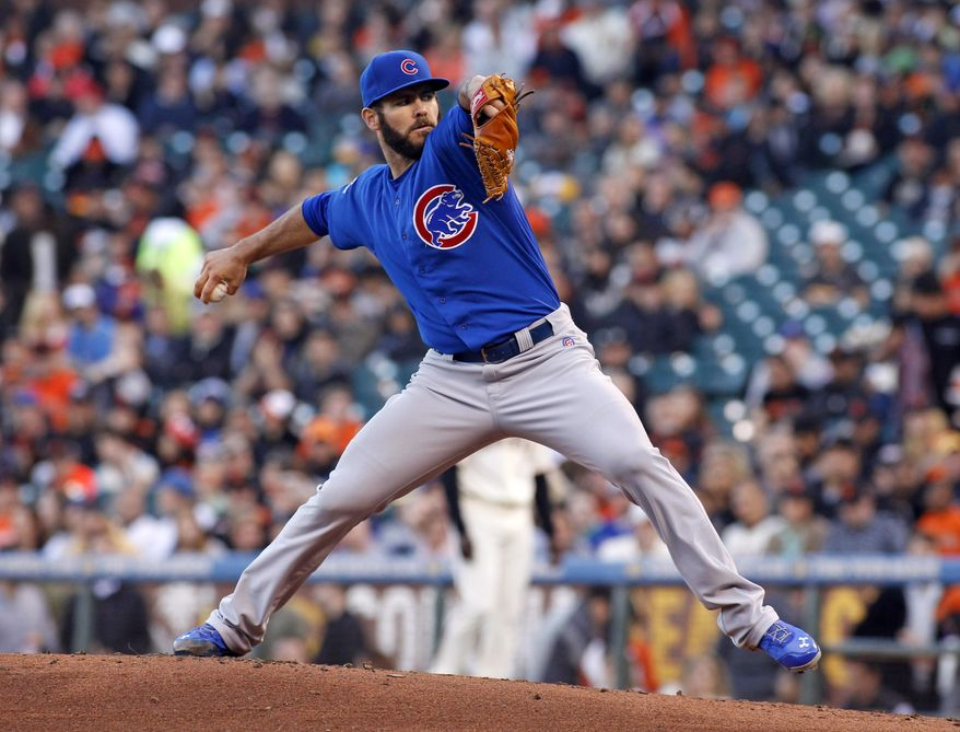 Chicago Cubs pitcher Jake Arrieta throws to the San Francisco Giants during the first inning of a baseball game, Tuesday, May 27, 2014, in San Francisco. (AP Photo/George Nikitin)