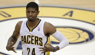 Indiana Pacers' Paul George gestures after hitting a 3-point shot during the second half of Game 5 of the Eastern Conference finals NBA basketball playoff series against the Miami Heat on Wednesday, May 28, 2014, in Indianapolis. (AP Photo/Darron Cummings)