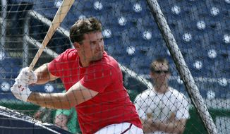 Washington Nationals third baseman Ryan Zimmerman bats during batting practice before a baseball game against the Miami Marlins at Nationals Park Wednesday, May 28, 2014, in Washington. Zimmerman is on the disabled list with a broken thumb, and was recently cleared to swing a bat. (AP Photo/Alex Brandon)