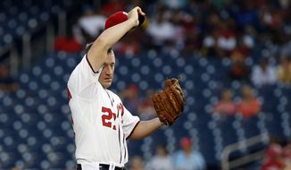 Washington Nationals starting pitcher Jordan Zimmermann wipes his brow before pitching during the third inning of a baseball game against the Miami Marlins at Nationals Park, Wednesday, May 28, 2014, in Washington. (AP Photo/Alex Brandon)