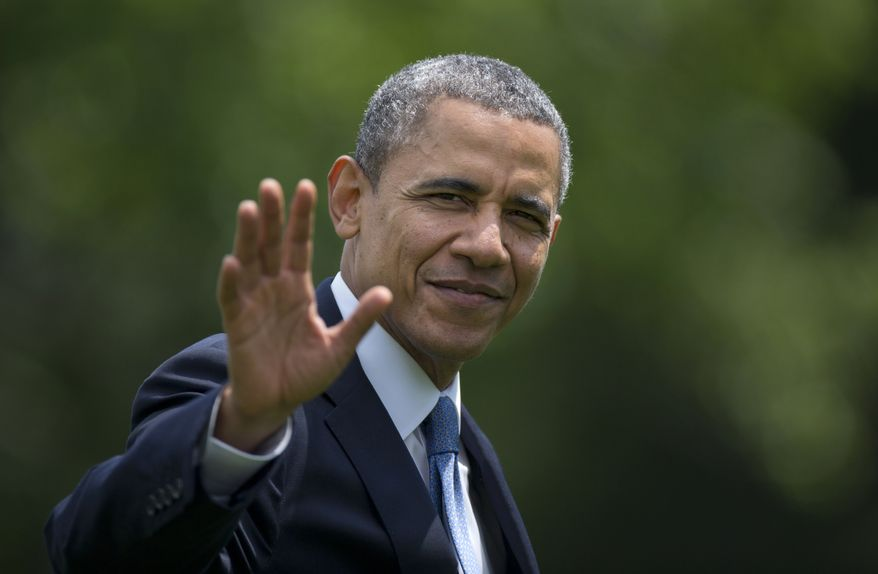 President Barack Obama waves as he walks from the Marine One helicopter to the Oval Office of the White House, in Washington,  Wednesday, May 28, 2014, as he returns from delivering the commencement address at the United States Military Academy at West Point, New York. (AP Photo/Carolyn Kaster)